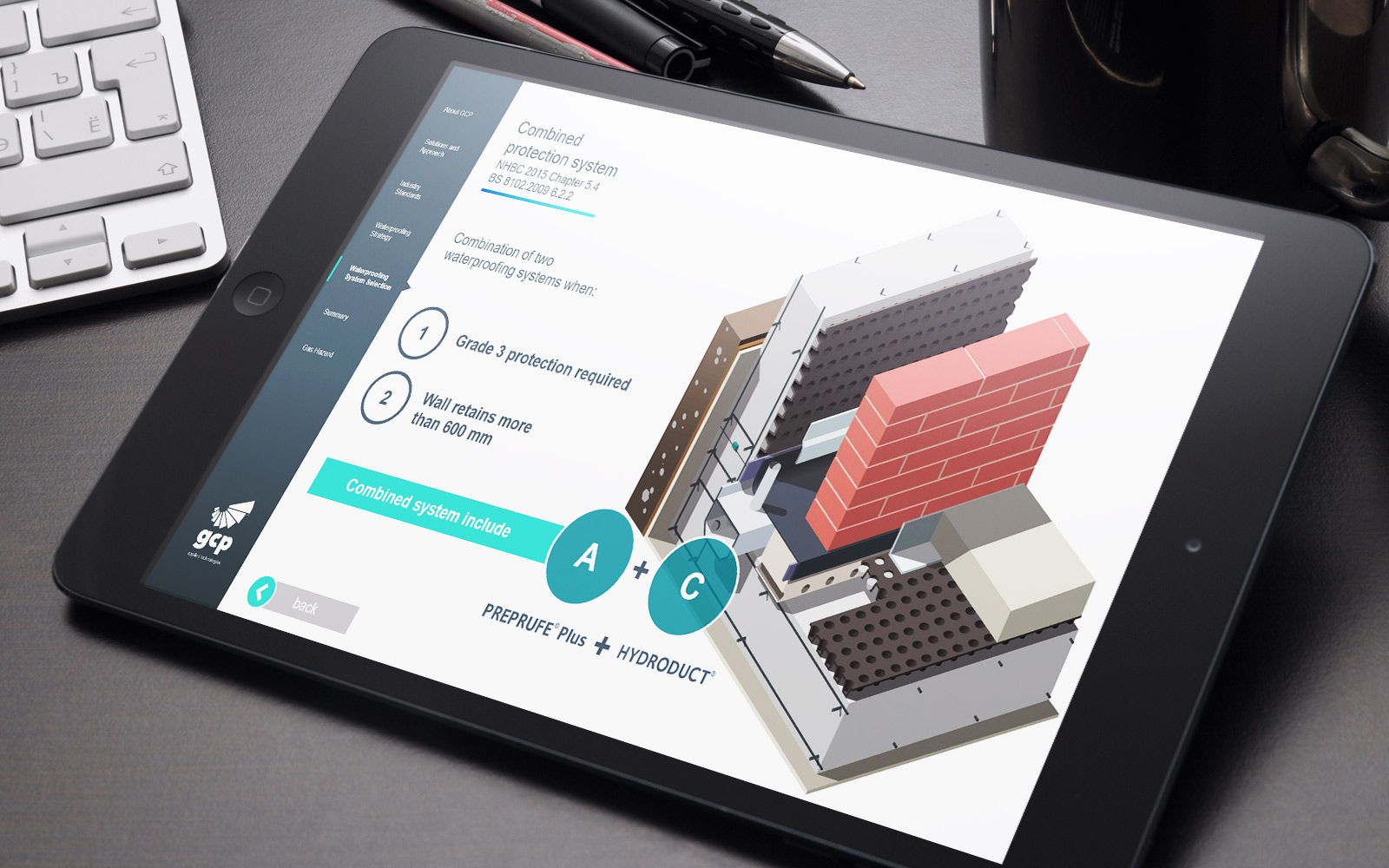 Black iPad displaying GCP interactive touchscreen sales enablement tool showing illustration of building materials in use