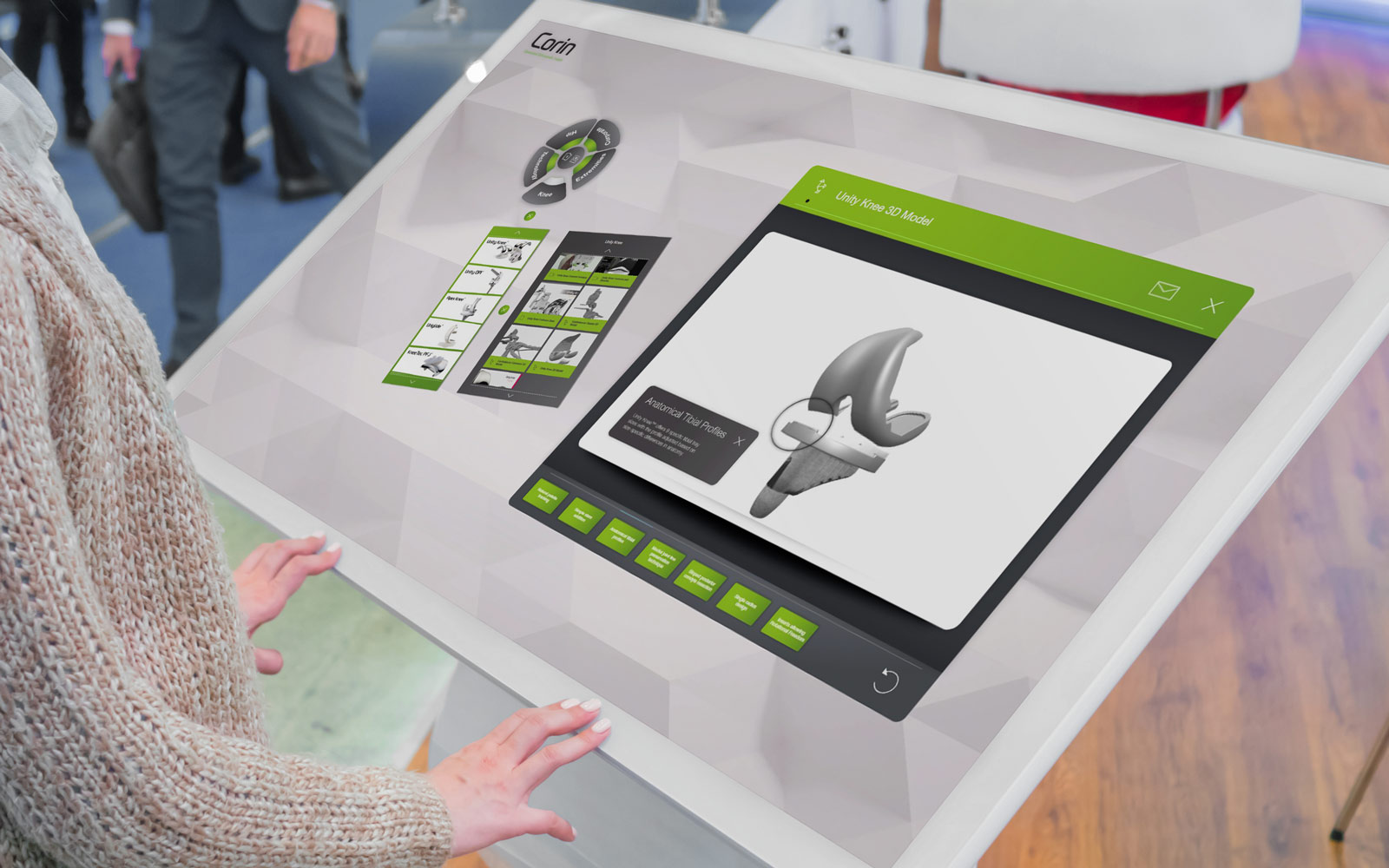 person interacting with Corin interactive touchscreen software displayed on large white tablet