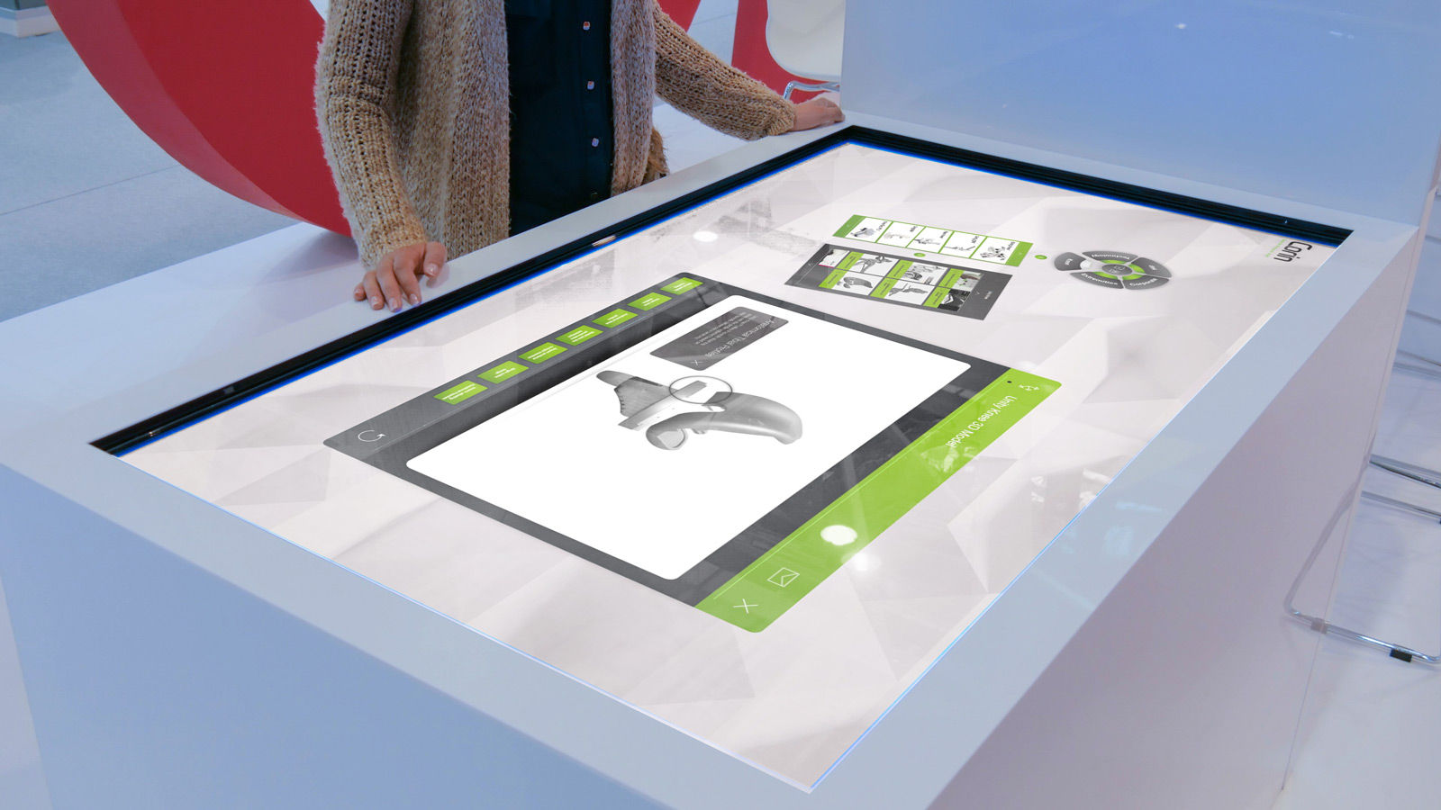 woman interacting with Corin interactive touchscreen software displayed on large white table