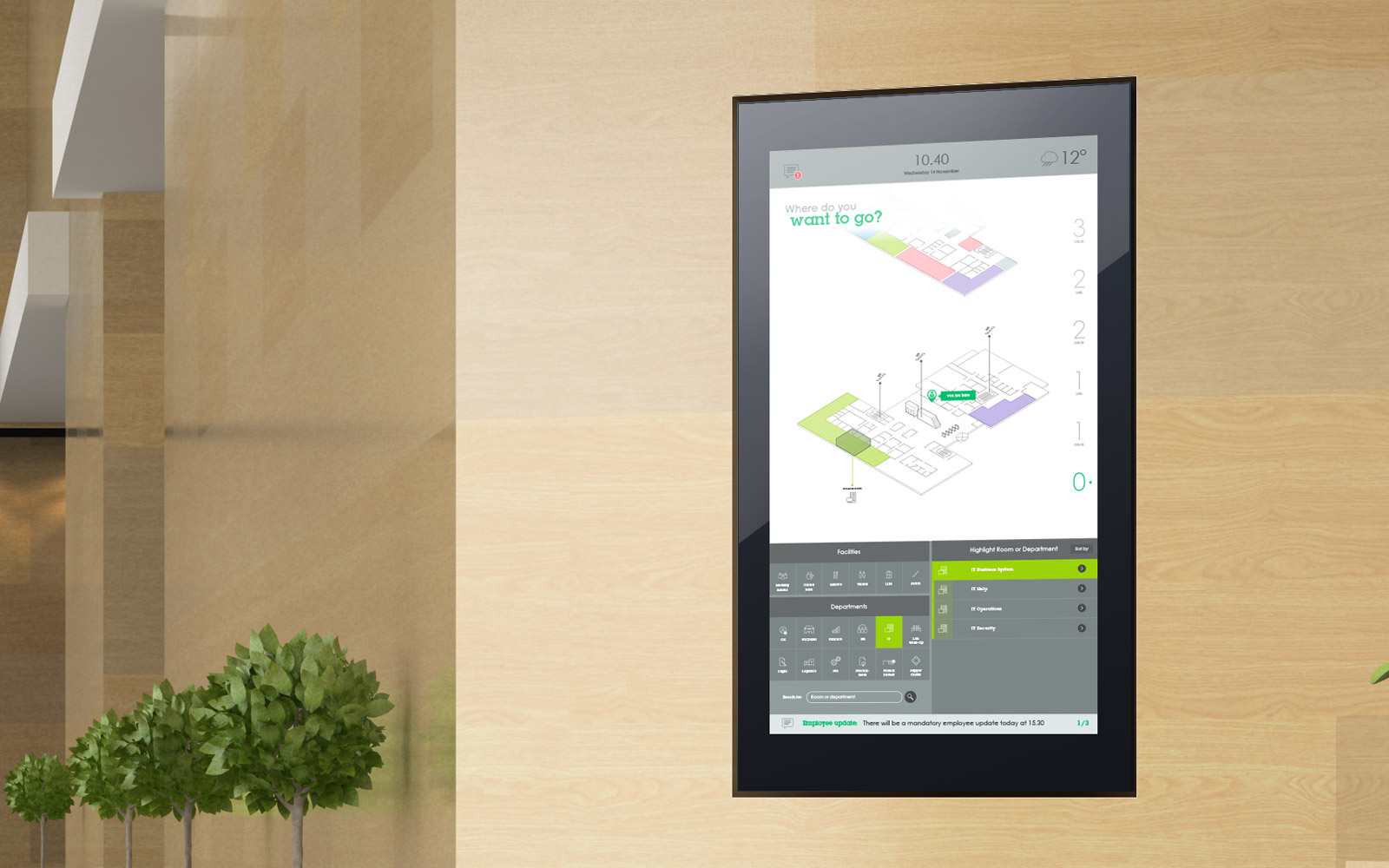 Interactive touchscreen software displayed on light beige wooden panel office wall
