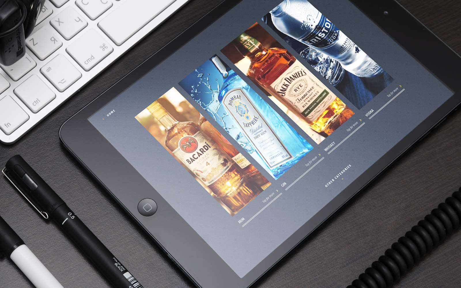 Black iPad displaying Bacardi Limited interactive touchscreen sales enablement tool showing Bombay Sapphire Jack Daniels Eristoff Vodka