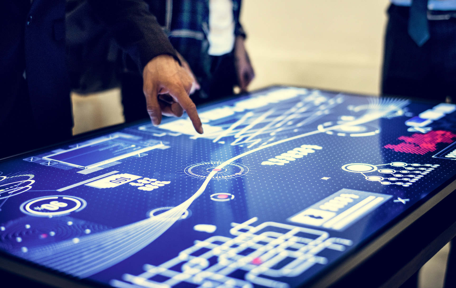 person interacting with touchscreen software