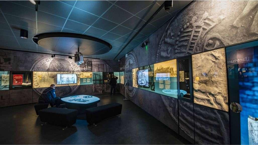 Royal Mint interactive digital software displayed using several large monitors across coin decorated walls