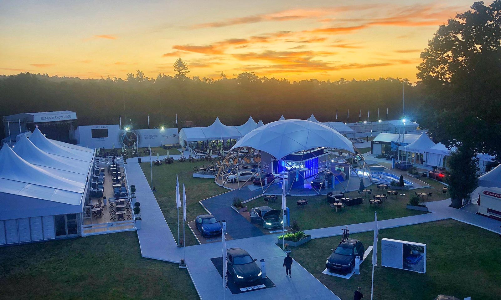 BMW interactive touchscreen software displayed at PGA Championship event at sunset