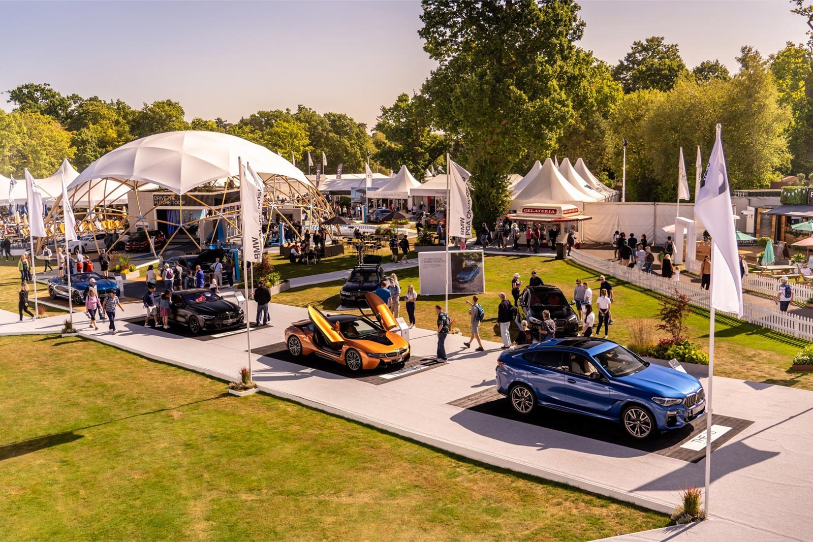 BMW interactive touchscreen software displayed at PGA Championship event gold blue black sports car