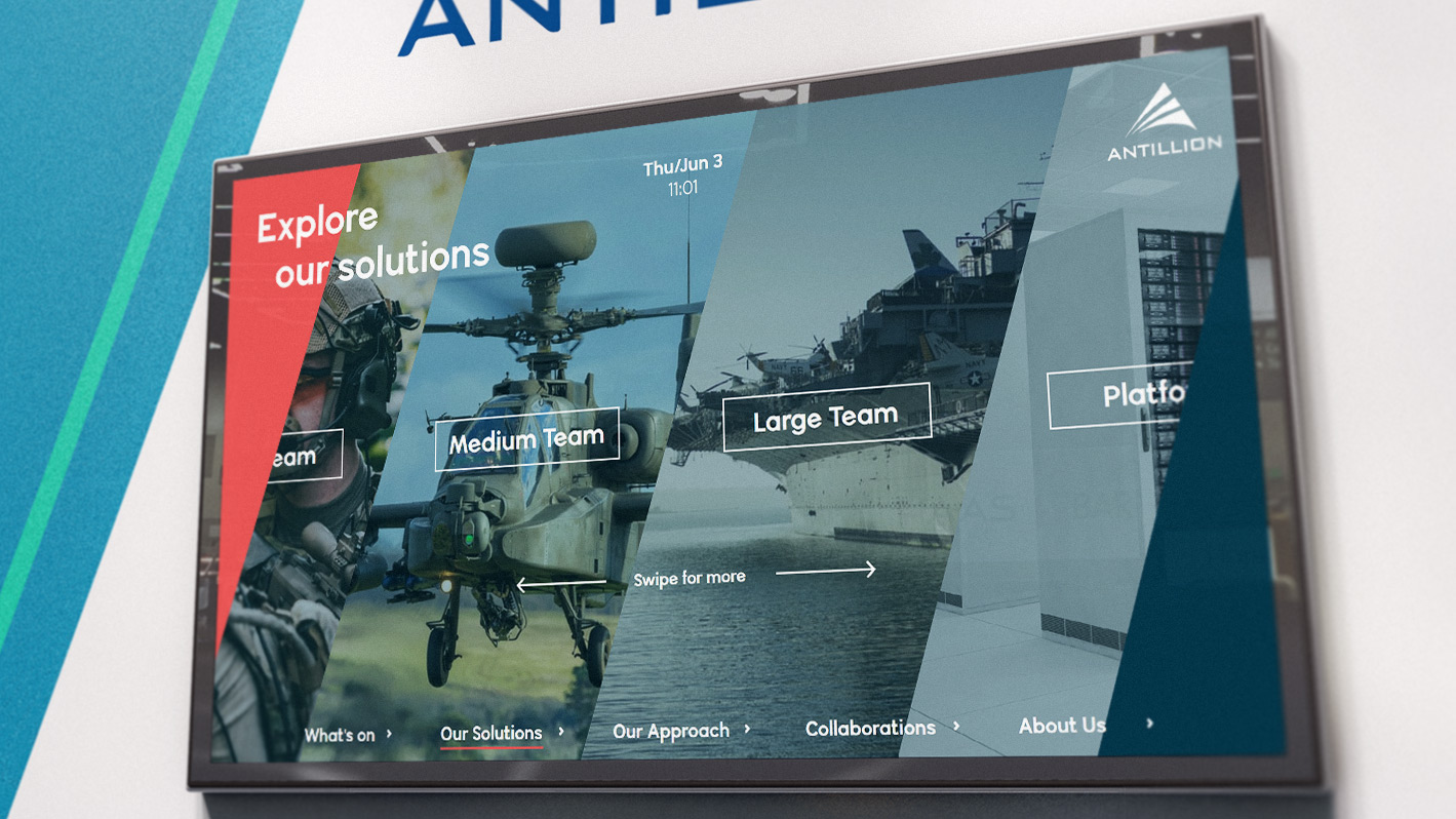 Antillion interactive software displayed on large screen on office wall