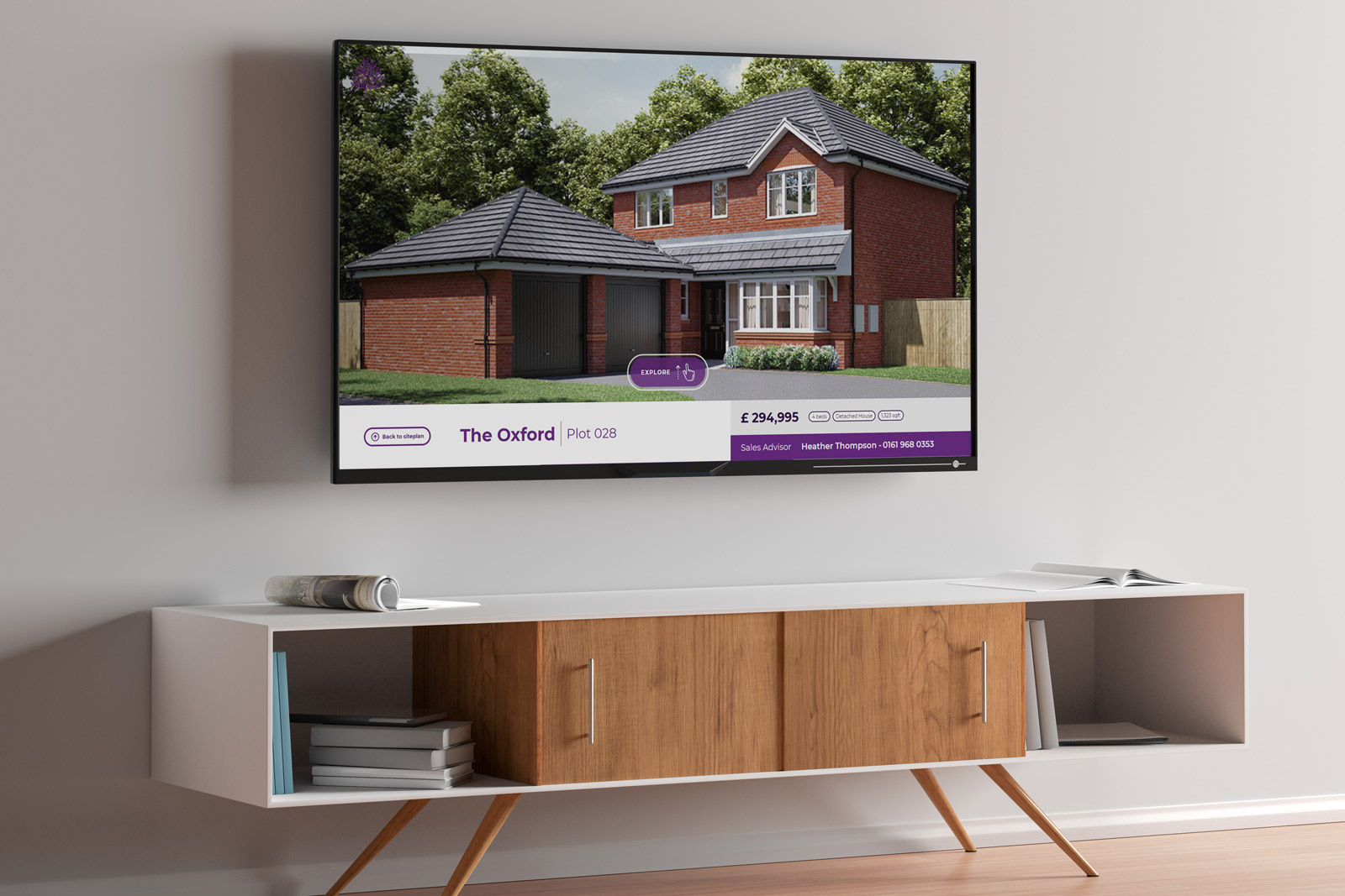 large black monitor displaying Laurus interactive presentation of house above white and wooden panelled cupboard