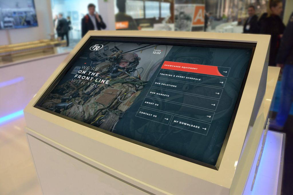 large white monitor showing Federal Response interactive touchscreen presentation