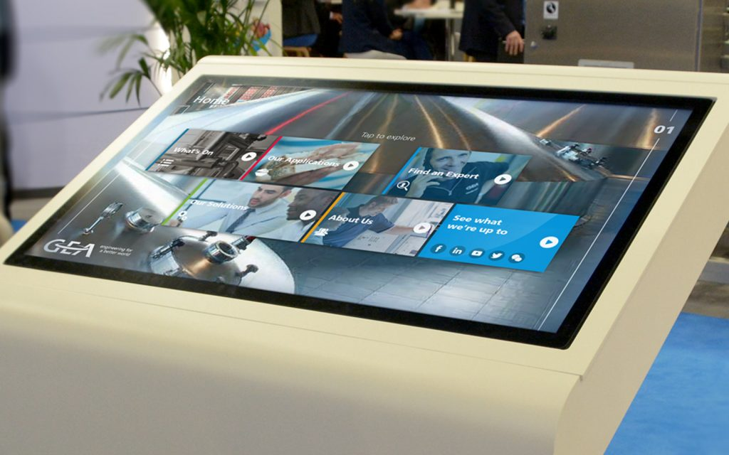 large white monitor showing GEA interactive touchscreen presentation