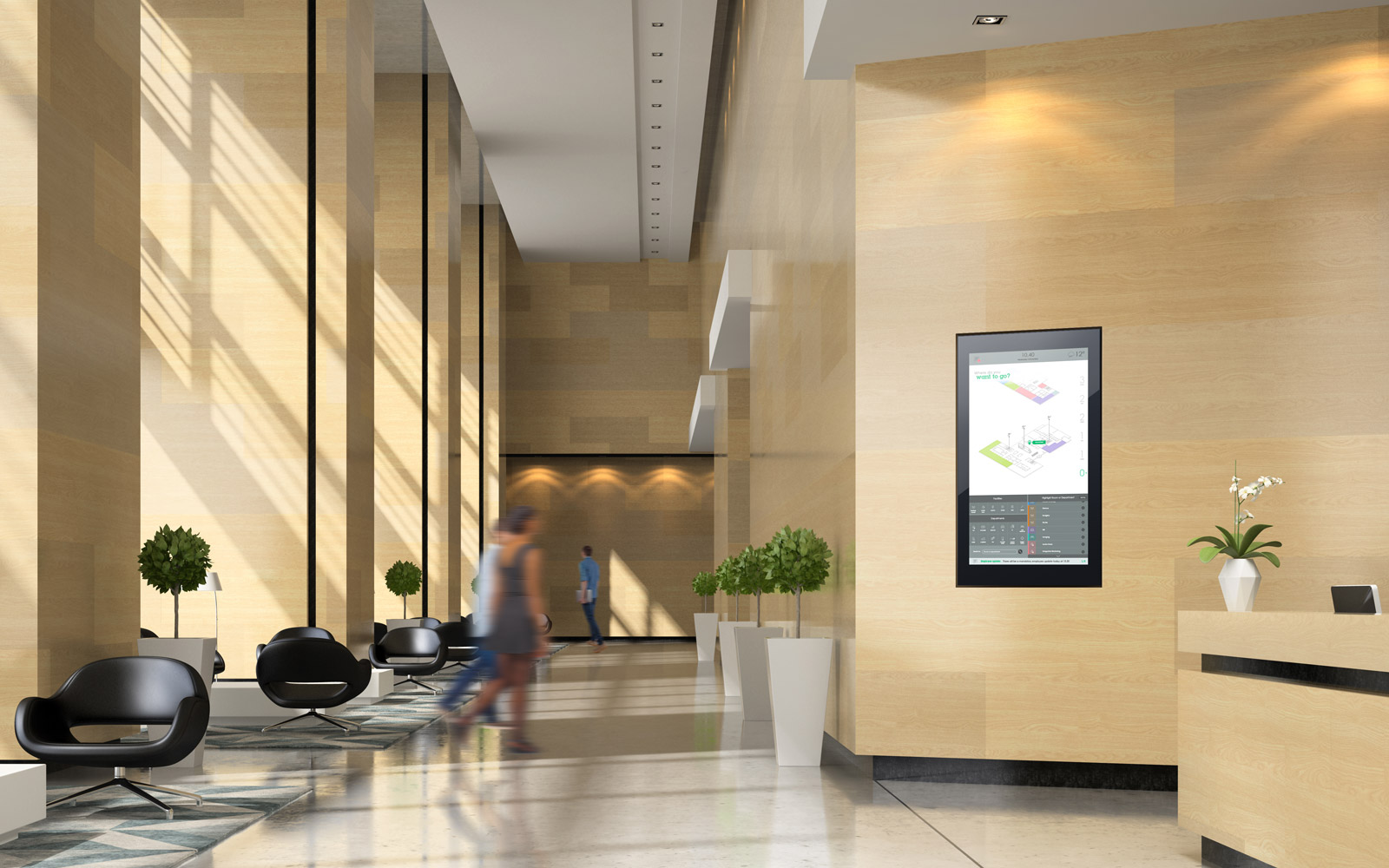 People walking through light beige wooden walled office reception with interactive touchscreen displayed between plants on right hand side
